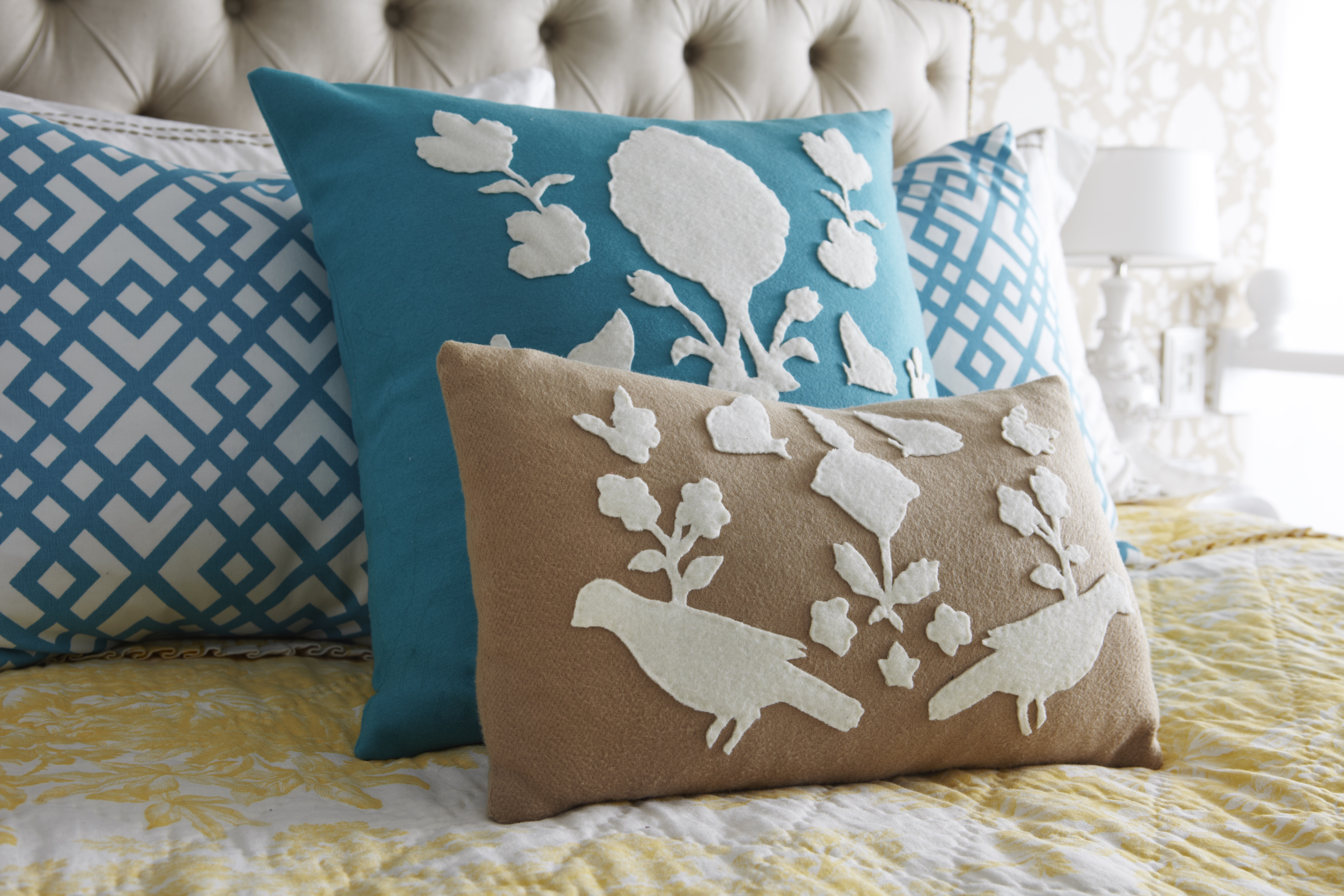 Paper pillow: felt appliqué from a wallpaper template living in a