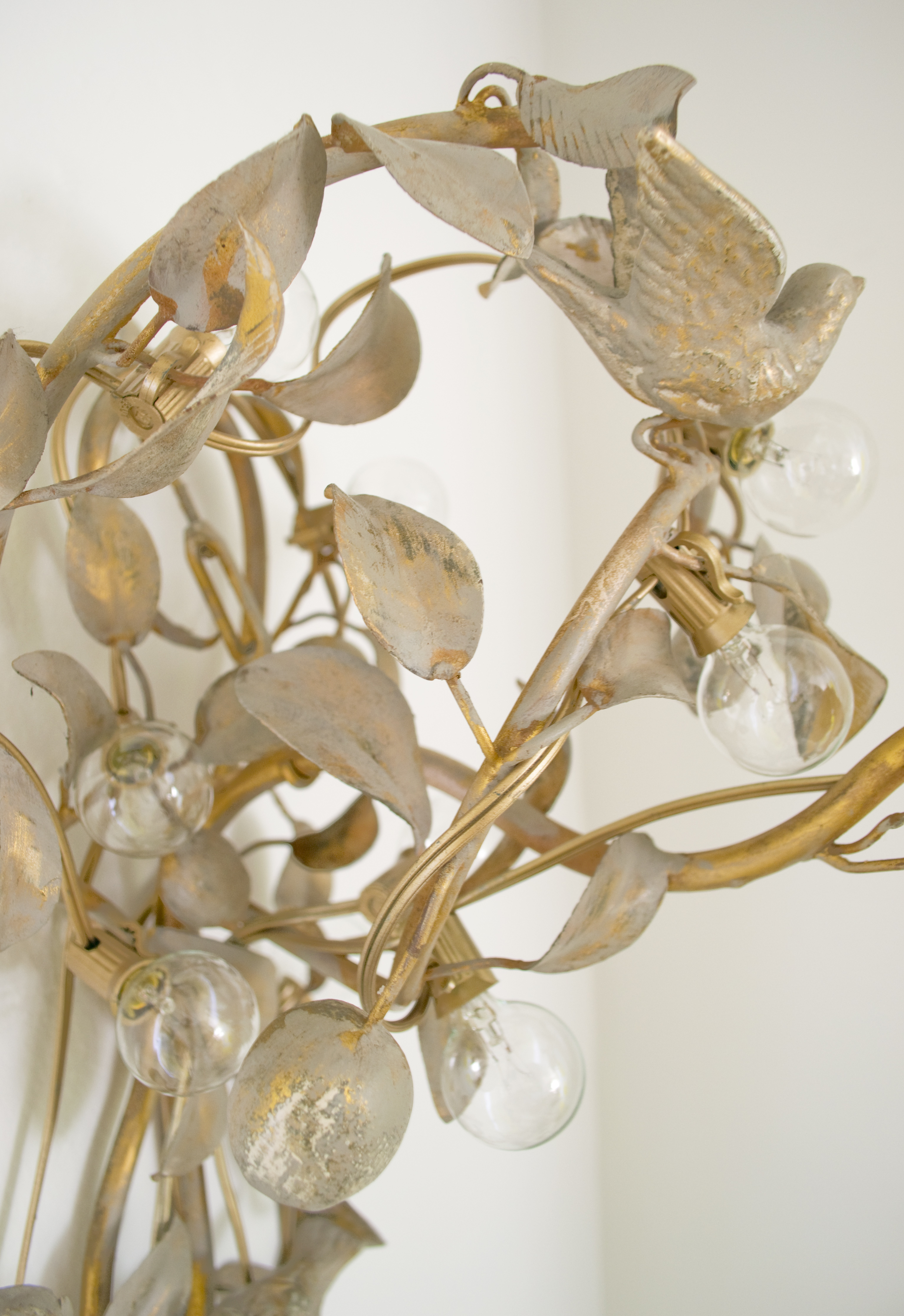 Vintage Light Sconce Wrapped With String Lights